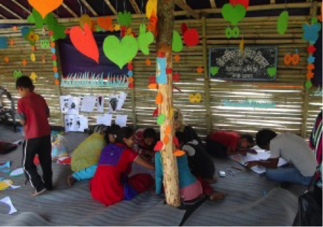 Temporary Learning Centers are built from local materials and joyfully decorated by the students themselves.